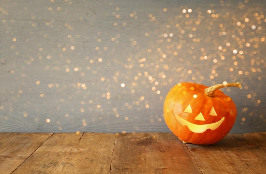 Cute pumpkin on wooden table